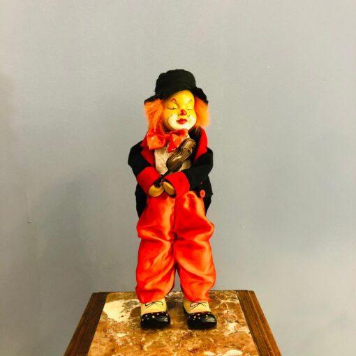Заводная игрушка-клоун двигающийся с музыкальным механизмом